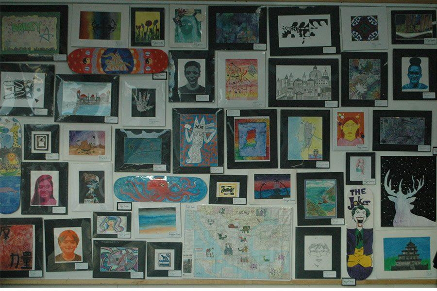 Different pieces of art are stacked together created by students from different Kettering schools.
