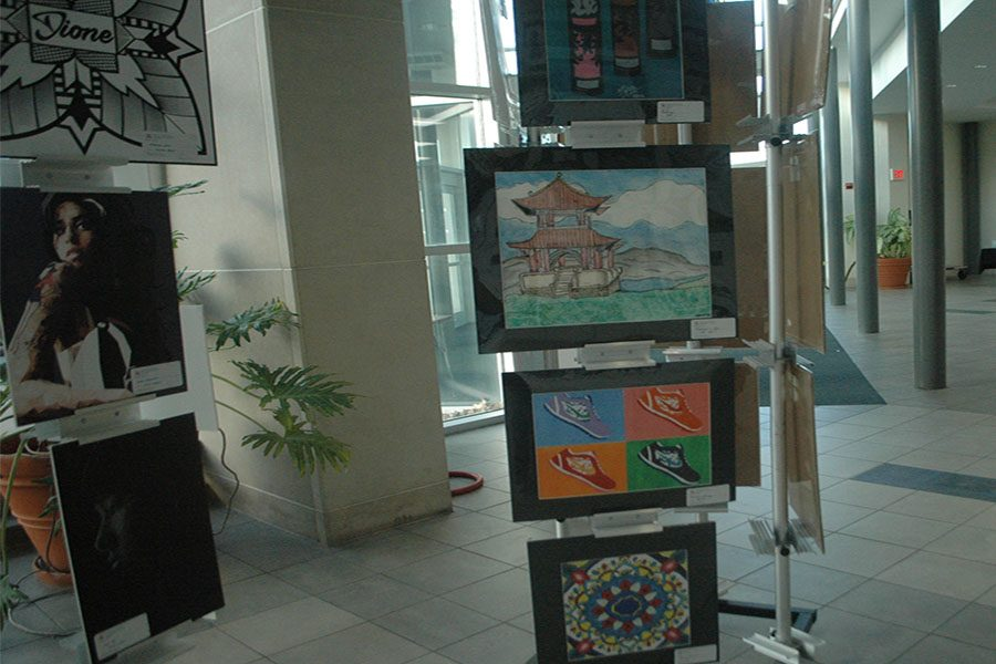 Artwork of Kettering students are stacked on top of one another.