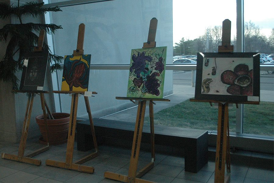 Three pieces of art displayed along Fairmont's front windows.