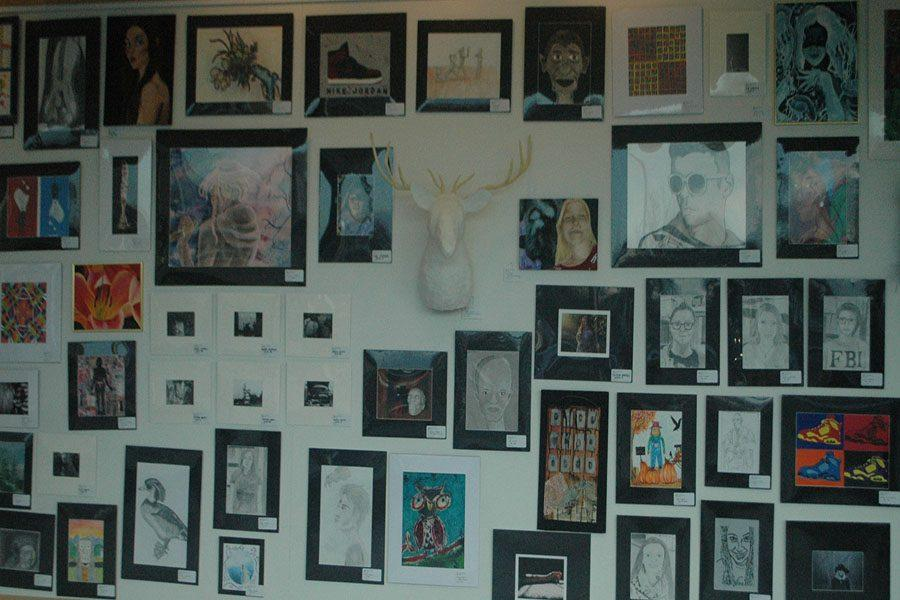 Different pieces of art  displayed on the wall.