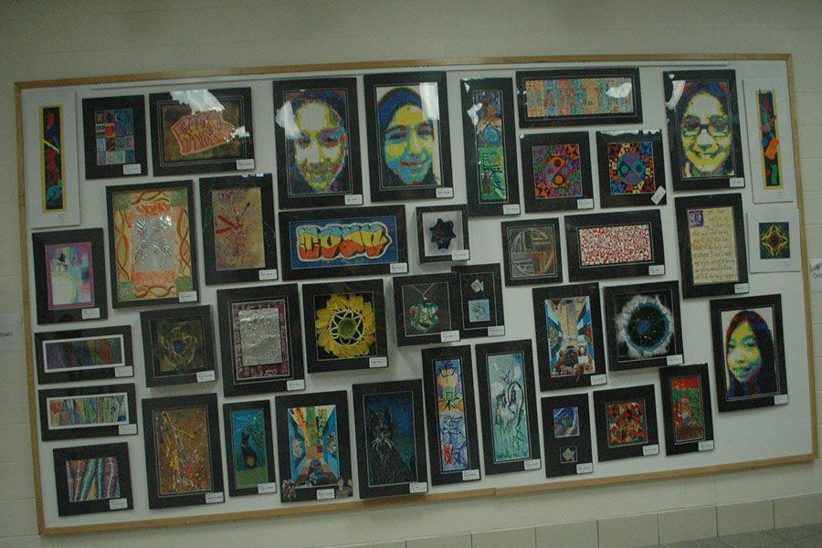 Stacked tightly side to side shows the student's works of art.