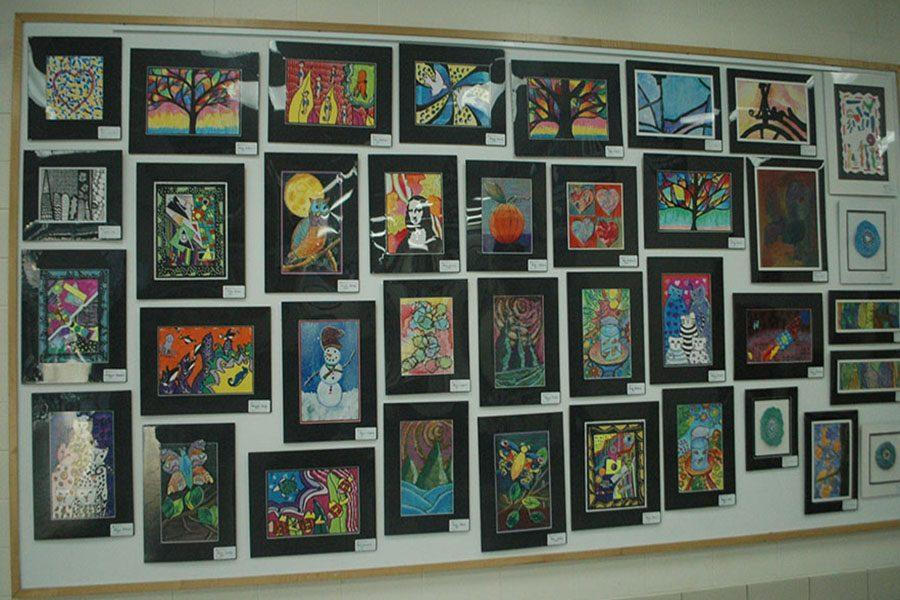 One of Fairmont's walls filled top to bottom with student artwork.