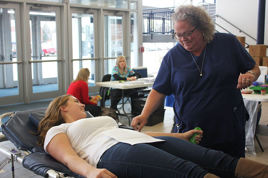 Sophomore, Kennedy Dedario donating blood at the annual spring blood drive.