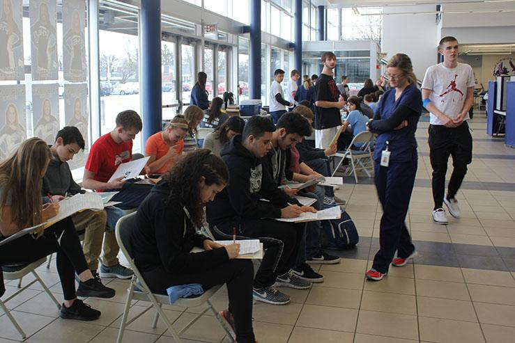 Students start the donating process by filling out the needed paperwork.