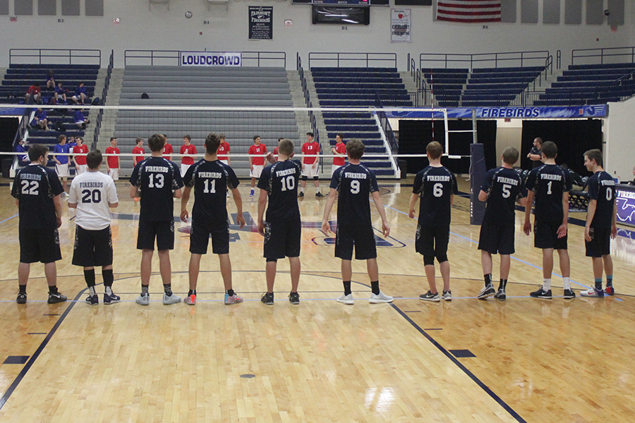 The+boys+volleyball+team+stands+to+announce+both+teams.+