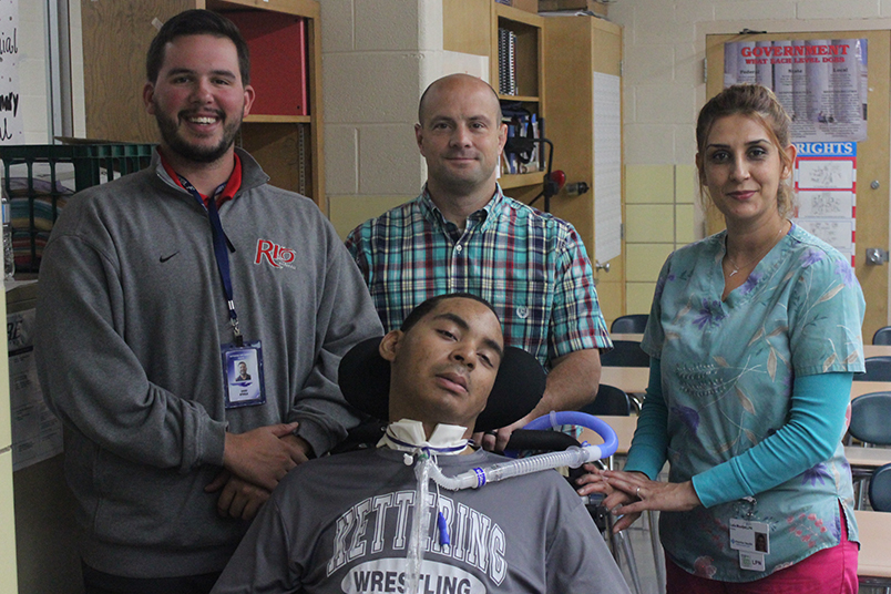 Ahmad Doucet alongside his aide, David Steele, Wrestling coach and teacher, Frank Baxter, and nurse Leila Younes, is on a mission to earn his high school diploma and graduate as a Firebird.  Doucet continues to show his determination and inspire those around him.