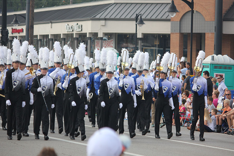 Fairmont's marching band makes its way through the street.