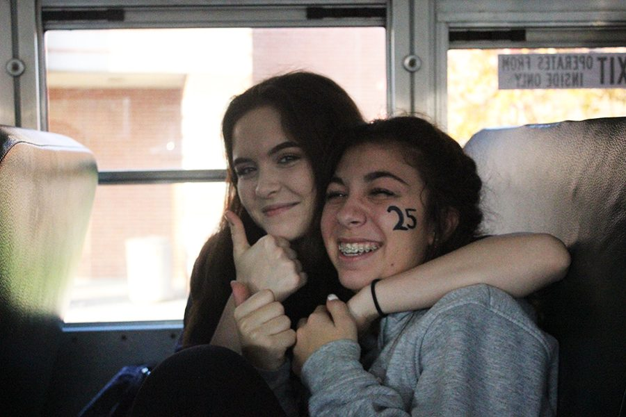 Sophomores%2C+Natali+Huber+and+Maria+Kiser+get+excited+on+the+Spirit+Bus.