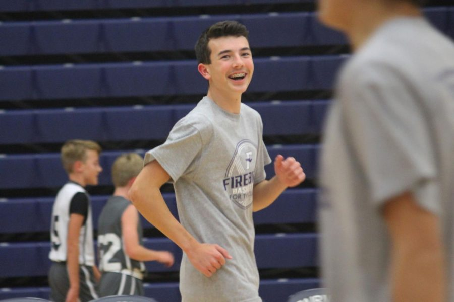 Sophomore, Mitchell Counts laughs as his team is warming up.