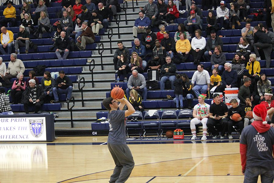 Junior, AJ Johns gets ready to shoot during half times's shoot out.