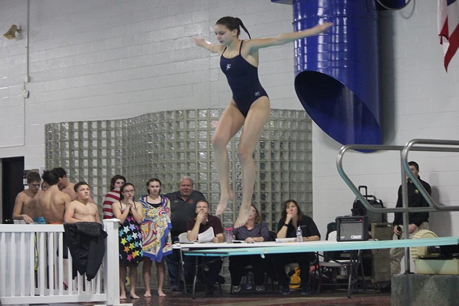 A+sophomore+from+the+Dayton+Regional+STEM+School+in+mid+jump+for+a+front+tuck+dive.