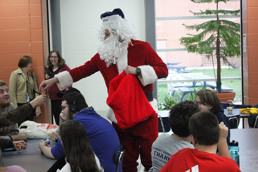 Santa Clause makes a special appearance at the Christmas party.
