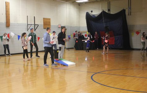 Senior Class Council students play corn hole with each other.