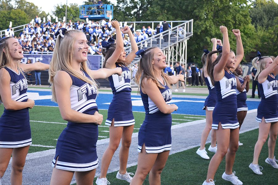 The varsity cheerleaders get the Loud Crowd involved at the beginning of the game.