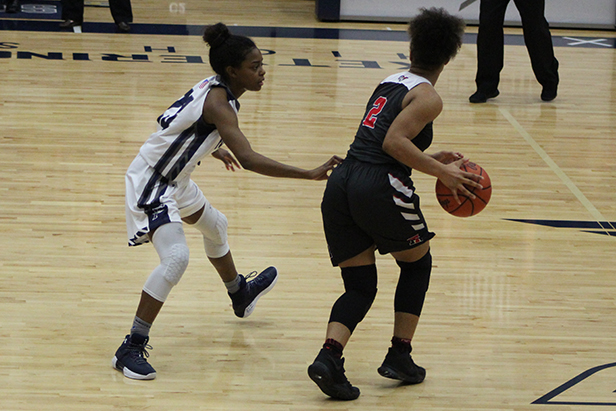 Junior, Makira Webster playing tough defense on her Trotwood opponent.