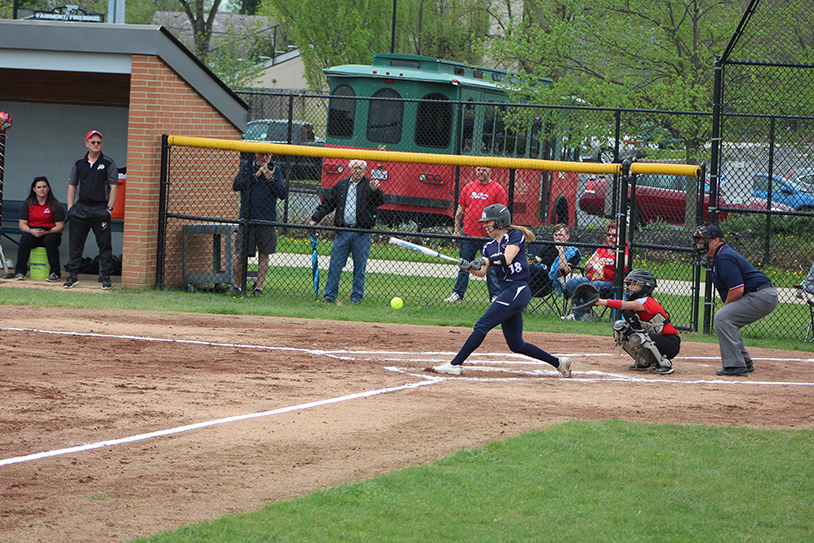 Senior, Rebecca Johnson hits a line drive down the third base line for a double.