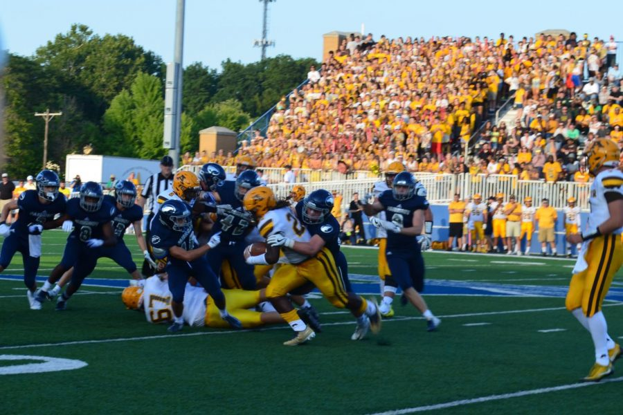Fairmonts defense wraps up an Alter player for a loss of yards.