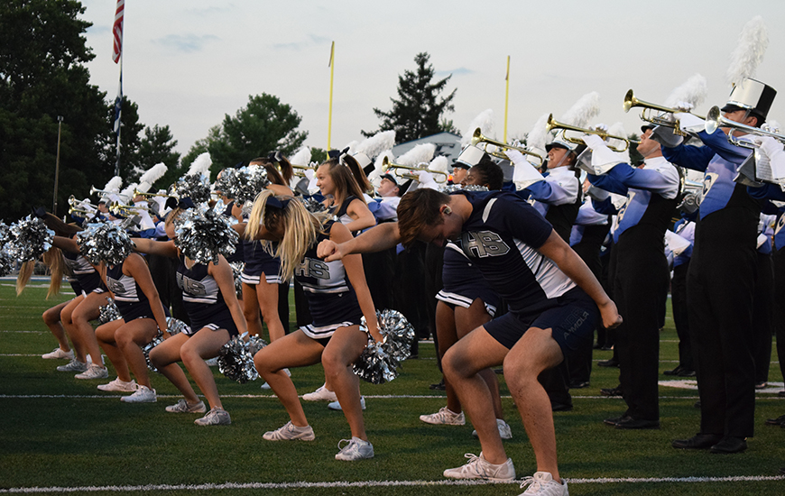 The varsity cheerleaders dance to the Fairmont Fight Song as part of a well-known tradition at all football games.