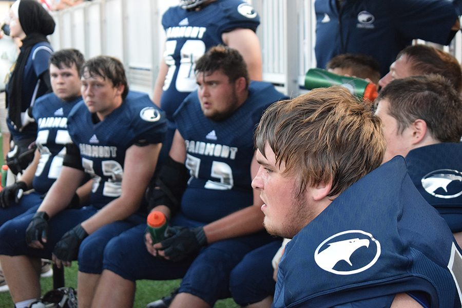 Fairmont senior Jake Childers, takes a break with this teammates during the first quarter of the game.