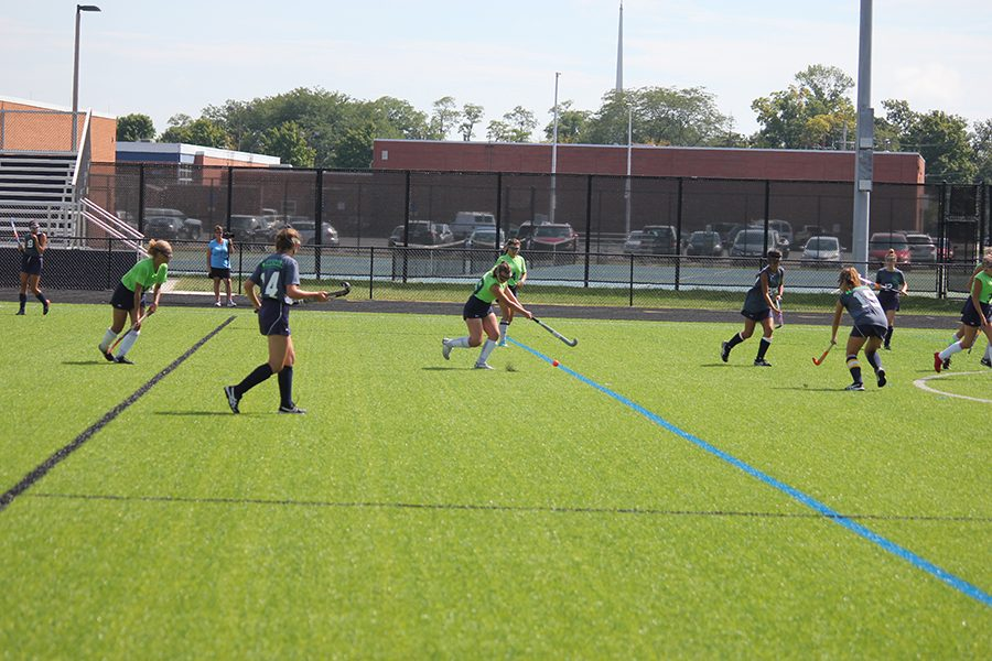 Senior Olivia Nevin shoots the ball trying to get towards the goal. Oakwood defends by shutting her out.