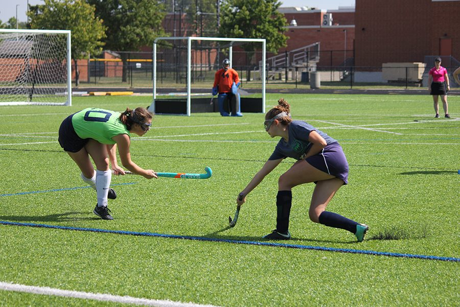 Junior Jackie Sherick defends the ball away from her opponent. Oakwood tries to get the ball back.