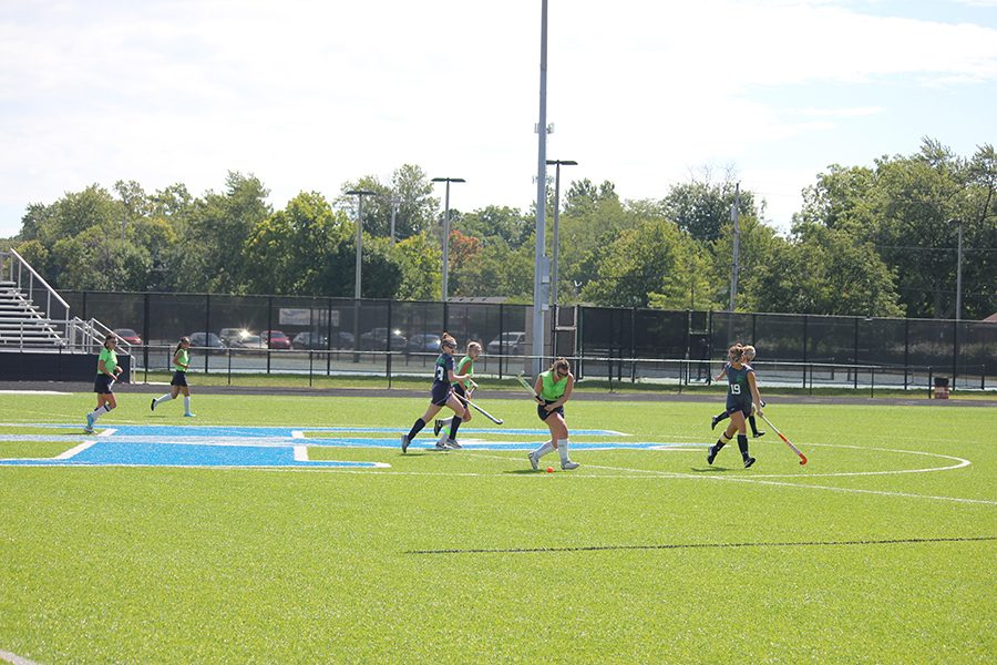 Senior Olivia Nevin aims the ball towards the goal. Oakwood stands ready to defend.