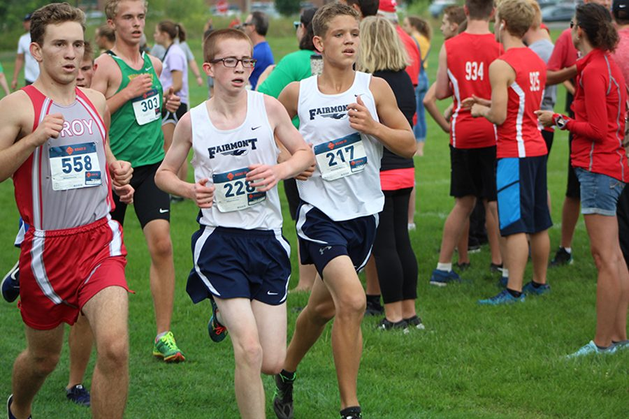 Freshman Max Kramer and Caleb Bartley are running in their first varsity meet at Northmonts' invitational. They start the meet at the same pace, beginning the race with a small lead.