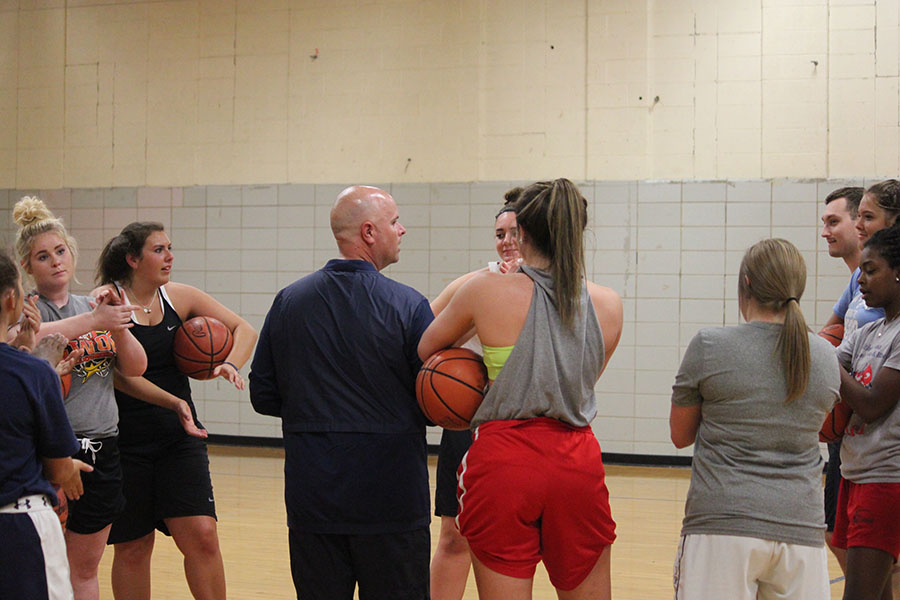 Jeremey Finn talks with his new team at a pre-season workout. The Birds have started weekly open gyms and weight lifting as they prepare for the upcoming season.