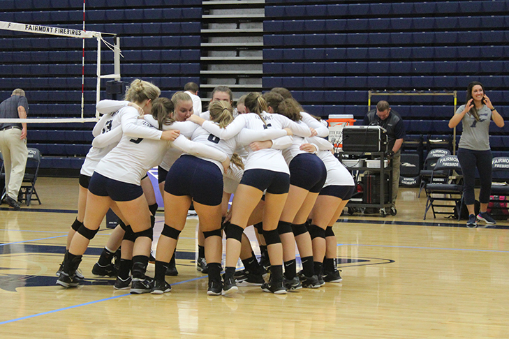 The Lady Firebirds get into a team huddle before their match against the Lebanon Warriors.