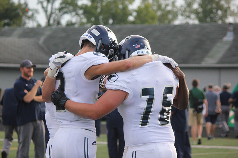Senior+captains+huddling+up+before+going+up+to+meet+their+opponents.+