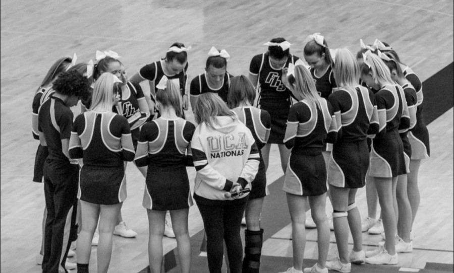 Head+Coach+Carrie+Kihn+huddles+with+her+team.+Kihn+has+been+coaching+cheer+at+Fairmont+for+19+years.